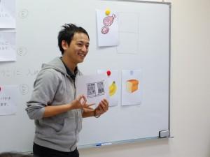 報告発表する上林宏樹さん。実際の授業でどのように教えるべきか、発表には入念な準備が必要だという